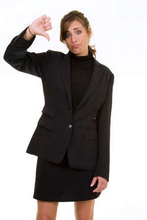 Attractive brunette woman in professional business suit standing on white pointing her thumb down photo