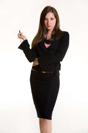 Attractive Business woman dressed in professional business suit standing on white background