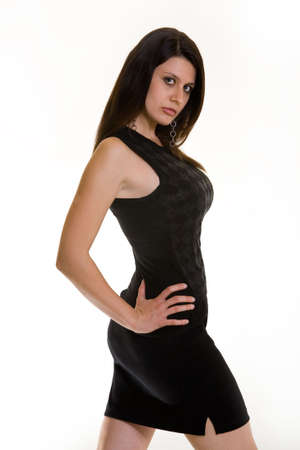 albanian: Attractive Albanian brunette woman wearing black casual clothing standing on white background