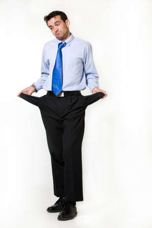 Full body of a handsome brunette young business man standing on white holding out empty pant pockets
