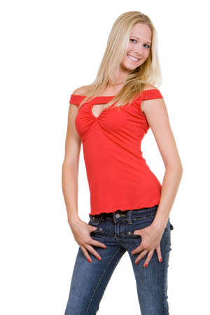 beautiful blond hair blue eyes woman wearing red top and jeans with a nice smile standing on white
