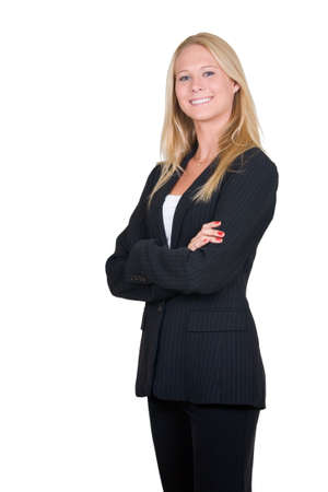 Attractive blonde woman in professional business suit standing sideways with arms crossed standing on white