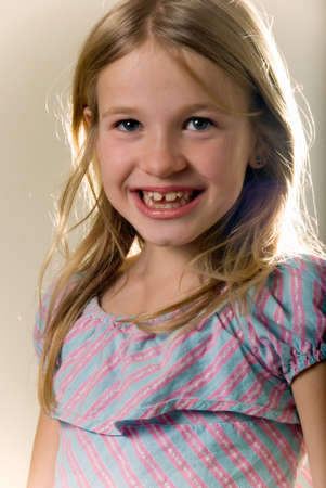 close up of face of a cute little blond eight year old girl
