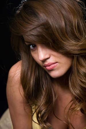 leaning forward: Close up of beautiful brunette woman leaning forward on black Stock Photo