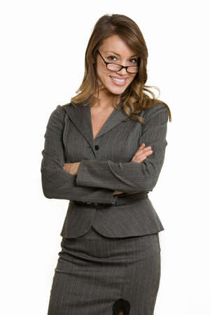 Attractive intelligent looking woman in eyeglasses wearing professional grey colored business suit standing with arms crossed on white