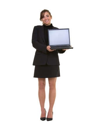 Full body of an attractive brunette smiling business woman holding up an open laptop computer showing the blank front screen looking confident standing on white