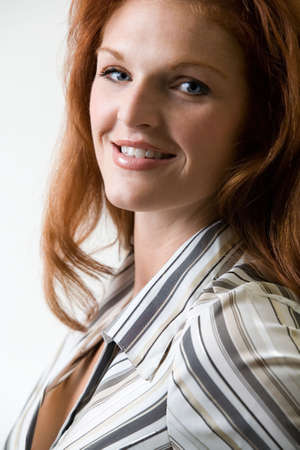 long red hair woman: Close up of beautiful with long red hair woman in striped top Stock Photo