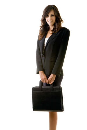 Full body of an attractive brunette business woman holding a briefcase looking confident standing on white Stock Photo - 1423172