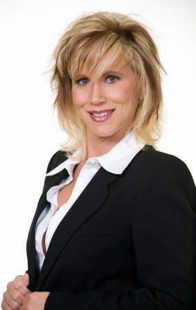 thirty something: Attractive thirty something blonde woman in professional business suit standing on white