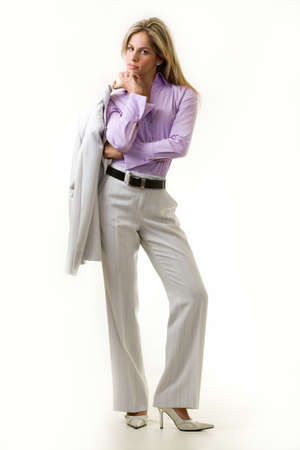 cream colored: Fulll body of an attractive blonde woman in professional cream colored business suit with light purple blouse standing on white  Stock Photo