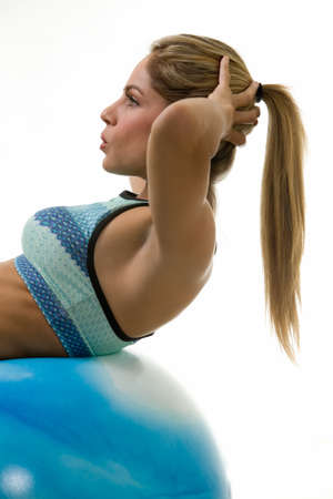 situp: Attractive blond woman in great physical shape using a ball to do crunches  Stock Photo