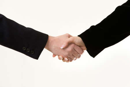 Two womens hands showing sleeve of business suit shaking hands Imagens