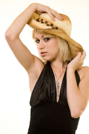Profile of beautiful young blond woman with blond hair wearing a straw cowboy hat and black top on white photo