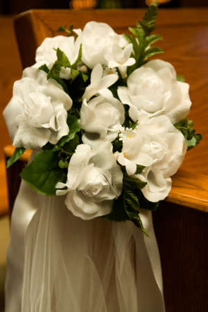 pew: Flower arrangement in a church on side of pew Stock Photo