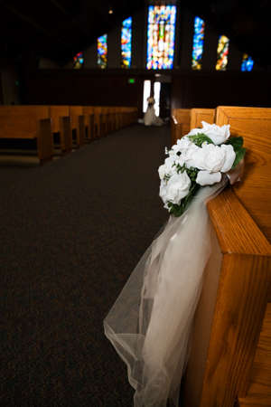 pew: Flower arrangement in a church on side of pew Editorial