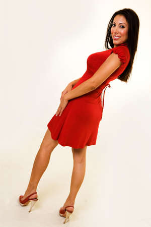 a beautiful young Hispanic American woman wearing red dress and matching shoes Stock Photo - 2085955