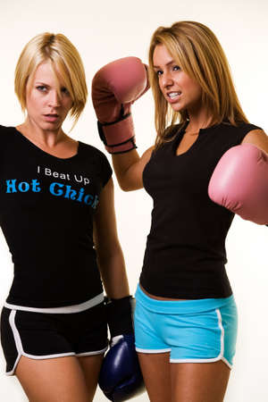 Portrait of two women wearing shorts and t-shirts with boxing gloves photo