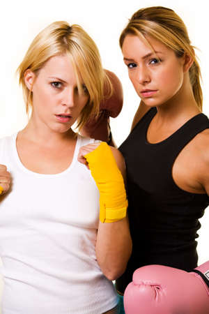 Portrait of two women wearing tank tops with boxing gloves photo
