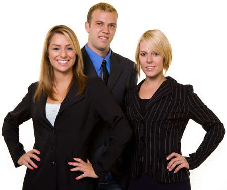 One business man in between two attractive confident business women both wearing dark colored business suits all smiling standing on white background Reklamní fotografie