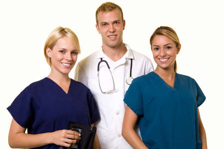 Two woman healthcare workers with one male in the middle wearing a doctors lab coat Standard-Bild