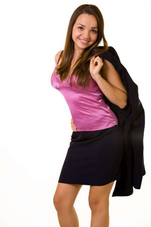 blazer: Attractive young brunette woman wearing business suit with jacket slung over shoulder wearing a hot pink satin undershirt standing with a happy expression on white Stock Photo