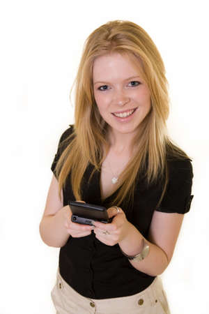 pager: Young attractive blond girl holding a pager text messaging looking up and smiling  Stock Photo