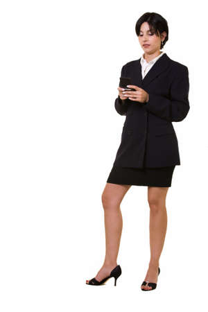 pager: Full body of an attractive brunette woman wearing business suit standing while holding a pager text messaging