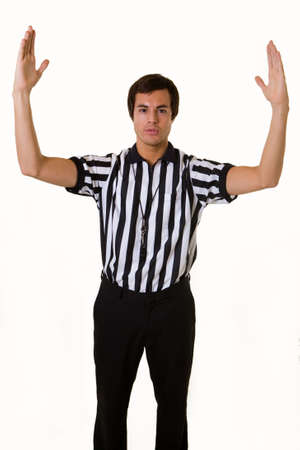Young brunette man wearing a referee striped black and white top holding two arms up Reklamní fotografie