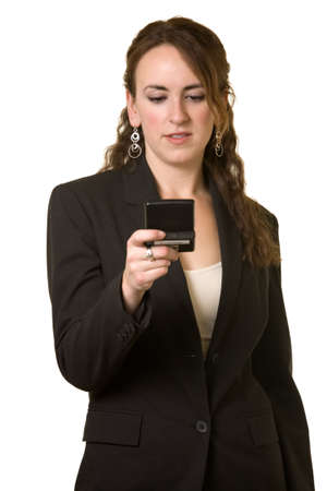 pager: Attractive young brunette business woman reading a pager with text messaging over white