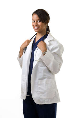 Female attractive African American doctor wearing white lab coat and a stethoscope around shoulders smiling standing on white background
