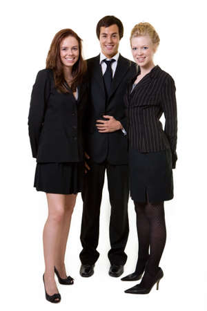 Full body of three business people wearing black business attire attractive women and one man all with friendly smiles  Imagens