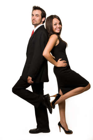 two friends: Full body of an attractive brunette woman standing with back up against an attractive man in business suit over white