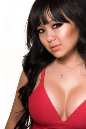Top part of a beautiful asian woman with long black hair wearing low cut red top over white
