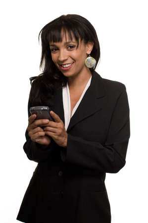 Attractive brunette Hispanic woman wearing business suit standing on white text messaging on cell phone with laughing expression photo