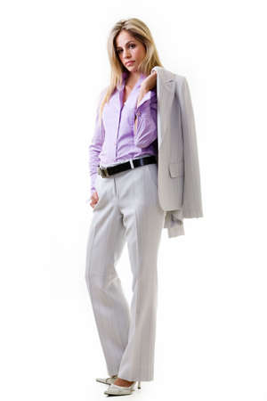 Fulll body of an attractive blonde woman in professional grey business suit with light purple blouse standing on white with jacket slung over shoulder  Reklamní fotografie
