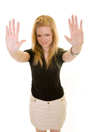 Attractive young blond woman holding up hands wearing silver thumb ring while standing on white