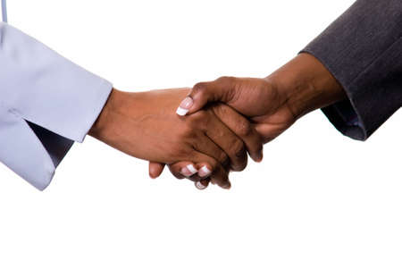 sleeve: Two womens hands showing sleeve of business suit shaking hands Stock Photo