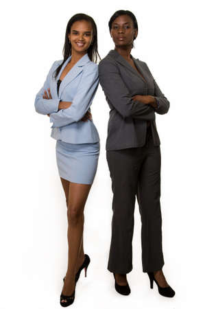 Full body of two African American business woman wearing business suits standing on white