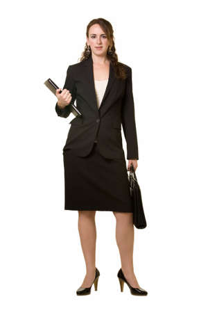 Full body of attractive brunette woman wearing black business suit with skirt standing over white photo