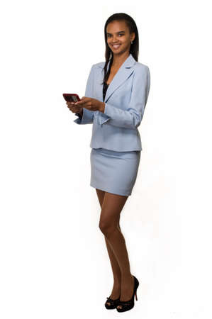 Full body of an Attractive African american woman wearing light blue business suit with skirt while using a pager Foto de archivo