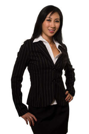 Attractive brunette Asianwoman wearing black business suit standing  on white  photo