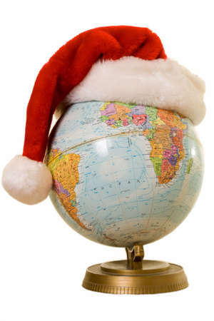 Round globe with a red santa hat showing concept of Christmas around the world