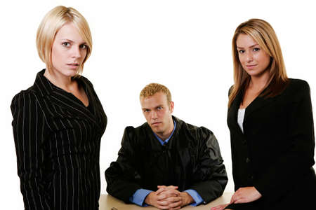 ruling: Portrait of two women lawyers with a male judge in between them all looking forward