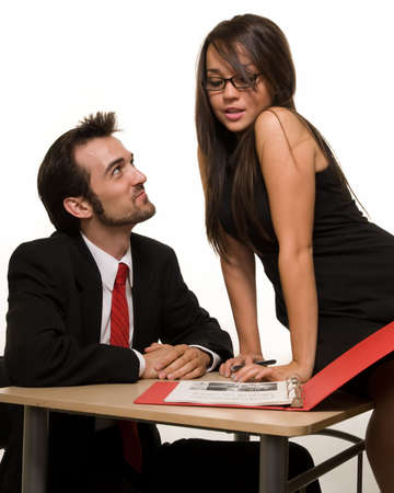Attractive brunette woman and business man in an office setting