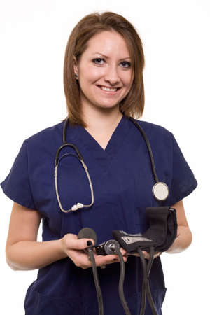 sphygmonanometer: Attractive friendly smiling young lady caucasian nurse with a stethoscope and sphygmonanometer standing on white