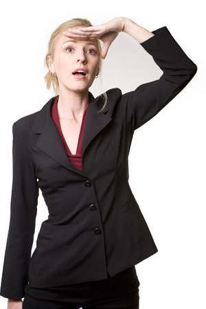 hair tied: Attractive blond hair woman wearing business suit with hair tied up looking ahead