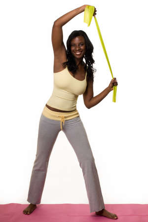 Attractive African American woman wearing workout attire standing  stretching Stock Photo