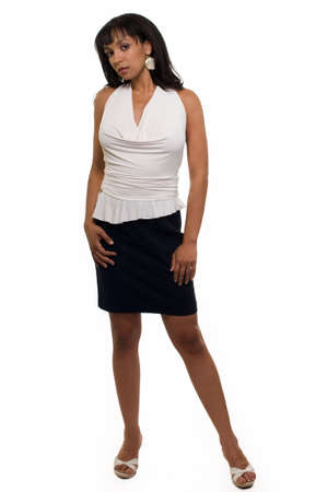 Full body of an attractive brunette woman wearing black skirt and white blouse standing on white