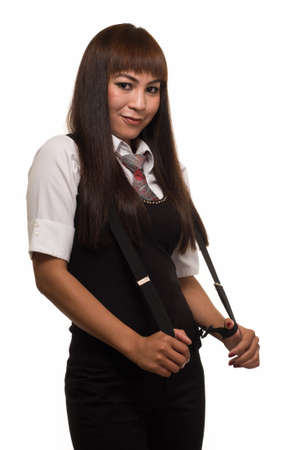 Attractive Asian woman wearing a business attire holding on to suspenders over white Stockfoto