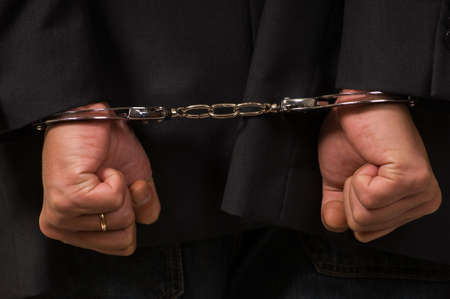 Male fisted hands up close in hand cuffs Stock Photo - 3905894